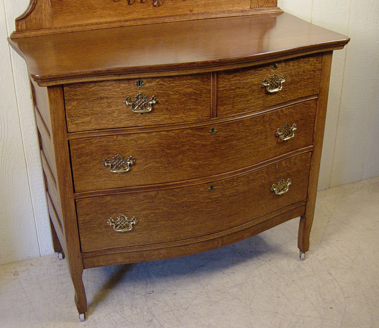 Oak Bow Front Dresser With Oval Beveled Mirror