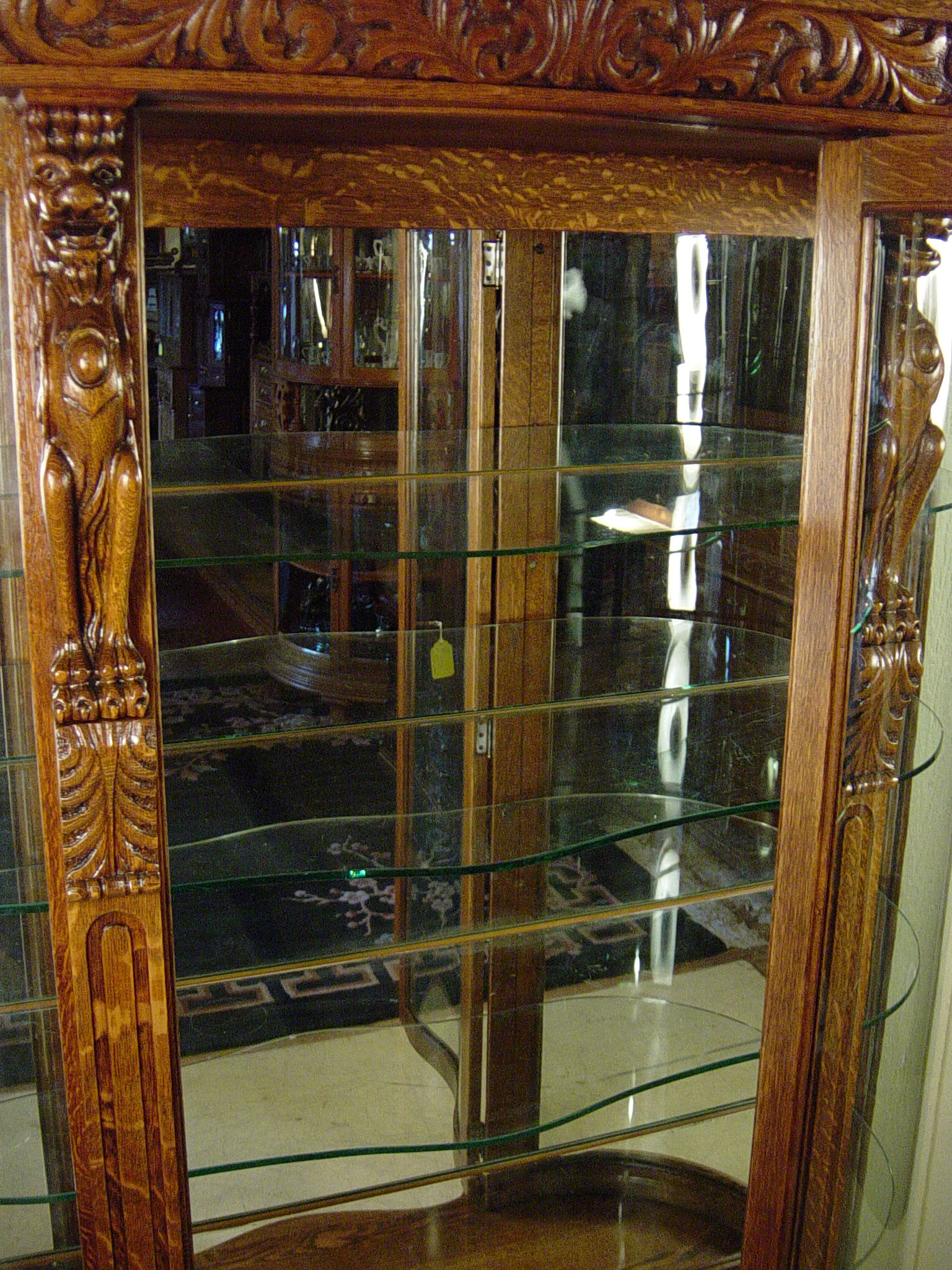 Oak Curved Glass China Cabinet With Carved Griffins